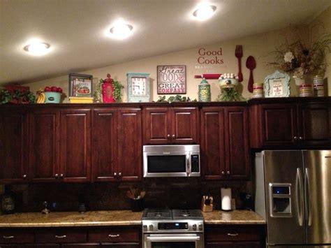 above kitchen cabinet decor ideas above kitchen cabinet decor home decor ideas