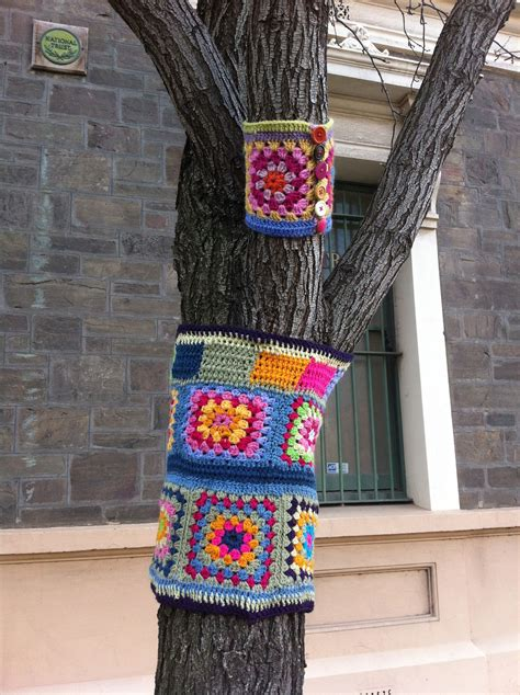 knit bombing yarn bomb tree yarn bombing