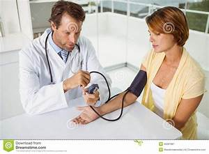Doctor Checking Blood Pressure Of Woman At Medical Office ...