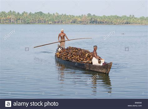 Small Boat In Hindi by Small Boat Traveling In Backwaters Of Kerala Carrying Huge