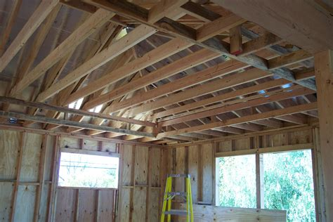 100 hanging drywall on ceiling trusses eliminating