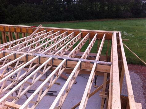 the second floor framing is supported by a joist attached to an inside structural wall