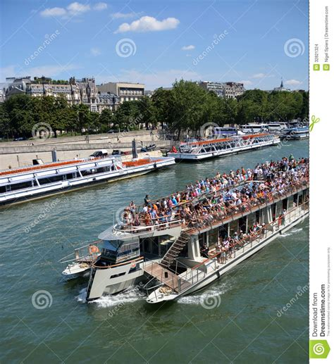 Boat Tour Paris Seine by Tourists On A Seine River Boat Tour Of Paris France