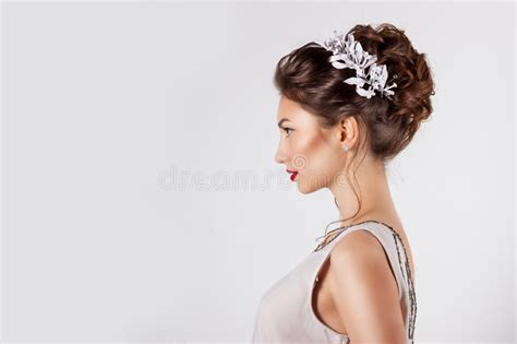 Beautiful Young Girl In The Image Of The Bride, Beautiful Wedding Hairstyle With Flowers In Her