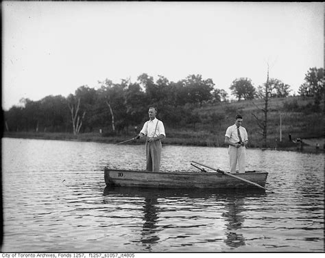 Two Men In A Boat by Vintage Fishing Photographs From Toronto
