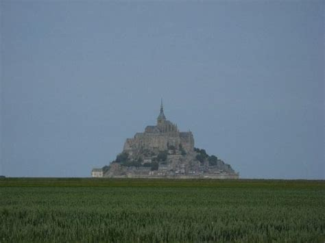getting our photo taken in front of mt st michel this place will be covered at high tide