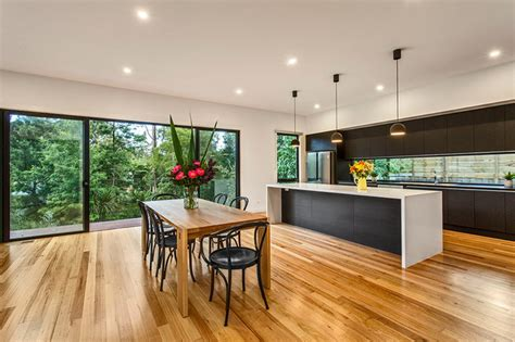 Open Plan Kitchen And Dining With Feature Windows