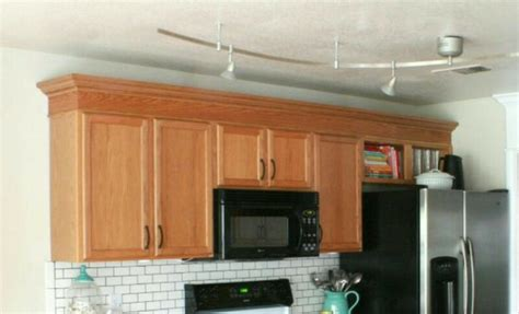 adding molding to cabinets add crown molding to the cabinet tops diy kitchens