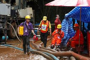 Warm in blankets, Thai boys smile and joke with rescuer in ...