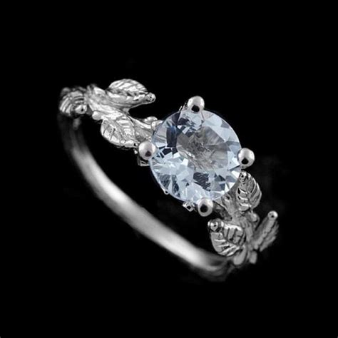 Hand Crafted Subtle Leaves Accent Round Aquamarine. Lesotho Iii Engagement Rings. Unique Wood Engagement Engagement Rings. Big Cat Wedding Rings. Royal Blue Rings. Wedding Cambodian Wedding Rings. Surprise Wedding Wedding Rings. Cornish Engagement Rings. Lock And Key Rings
