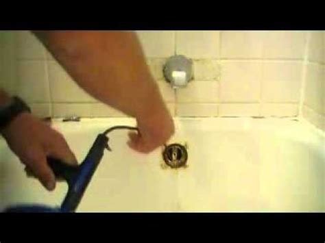 how to snake out a bathtub drain