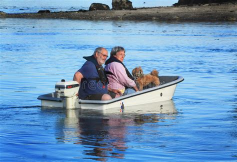 Dog Motor Boat by Couple With Dog On Small Boat Stock Image Image Of