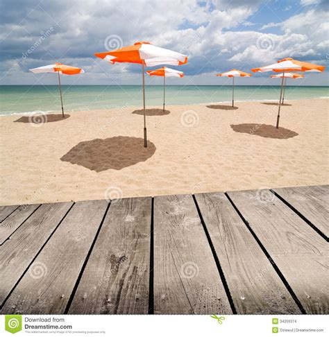 Umbrellas On The Beach And Empty Wooden Deck Table Stock. Upright Piano Desk. Walnut Side Table. Thomson One Help Desk. Portable Router Table. Cast Iron Table Bases. Pool Tables Sears. 36 Inch Table Legs. Stiga Baja Outdoor Table Tennis Table