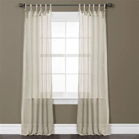 taupe joss and and curtain panels on