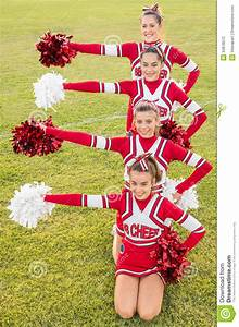 Happy Cheerleaders Forming A Huddle Royalty-Free Stock ...