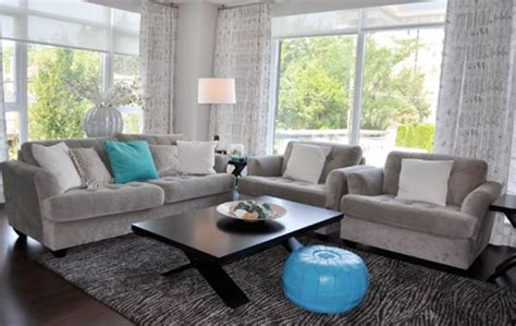 grey brown and turquoise living room moroccan pouf and turquoise accents shine in a gray living