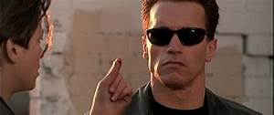 What does John Connor grab between his two fingers when ...