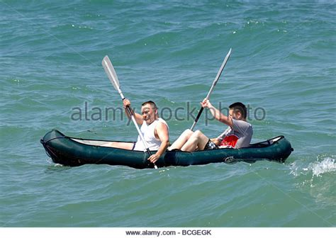 Two Men In A Boat by Two Men In A Boat Stock Photo Picture And Royalty Free
