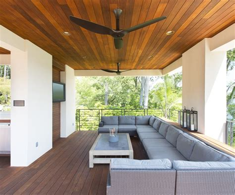 Outdoor patio ceiling fans patio traditional with wood ceiling green pillows transom windows