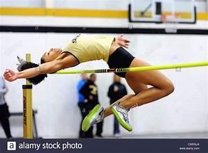 High Jump Female athlete clears the bar on a high jump ...
