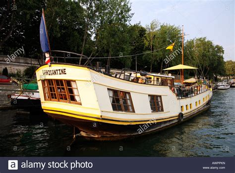 Houseboats Paris by Houseboat On The Seine River Paris France Stock Photo