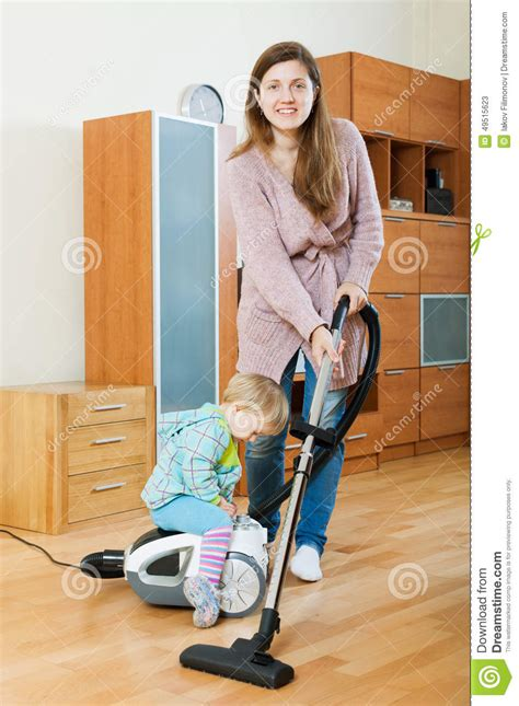 Mother With Baby Cleaning Living Room Stock Image Image