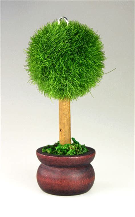 le marque place petit arbre rond pot de terre noel