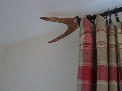 curtain rod finial and tiebacks made from antlers popsugar home