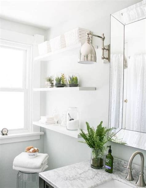 glossy white furniture with chic fresh bathroom plant decor inspiration on marble