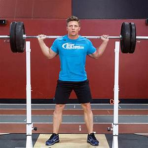 Barbell Squat Exercise Guide and Video