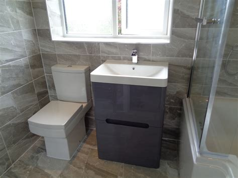 Refitting Bathroom In Stratford Upon Avon With Grey Theme. Circular Door. Black And White Tiles. Hite Company. Kensington Pivot Mirror. Maple Lawn Farms. Breakfast Nook Bench Seating. Tropical Lamps. Table Bench With Back