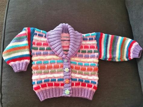 A Knitted Fun Hokey Multi Coloured Cardigan Made With Wool.