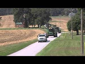 John Deere Combines and Tractors on the Move During Corn ...