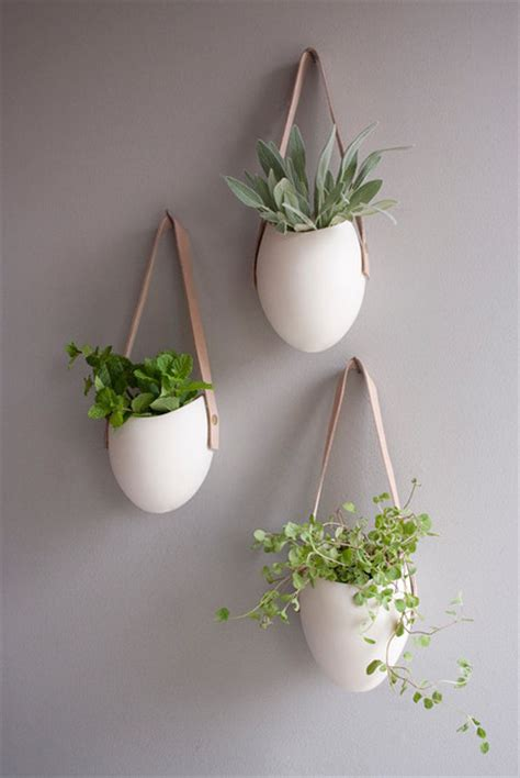 set of 3 porcelain and leather hanging containers by fashioned by modern indoor pots and