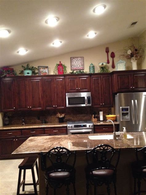 above kitchen cabinet decor 25 best ideas about above cabinets on above