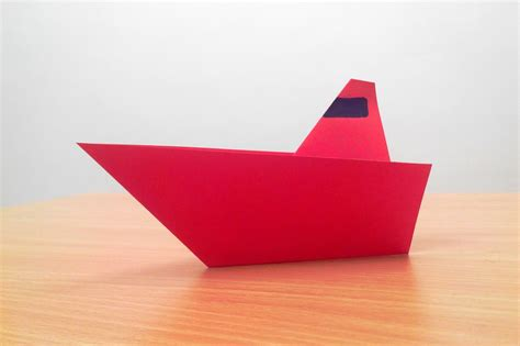 How To Make A Paper Boat Step By Step With Pictures by Origami White And Blue Paper Boats Psdgraphics Paper