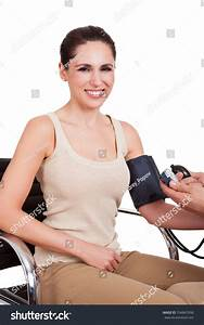 Doctor Checking Blood Pressure Of Young Woman. Isolated On ...