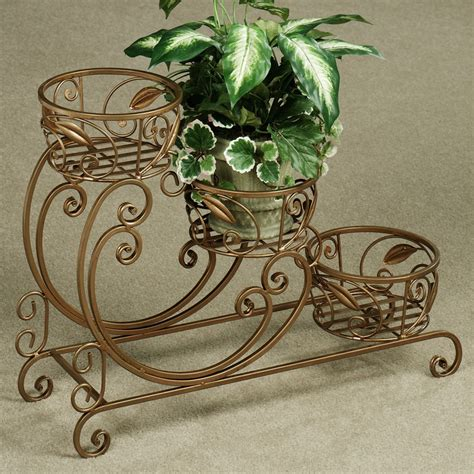 Wrought Iron Plant Stands Ideas — The Homy Design. Glam Room Ideas. Bookcase. Sonoma Backyard. Step Ideas. Vinyl Concepts. Tub Table. Nailhead Bar Stools. Bronze Backsplash