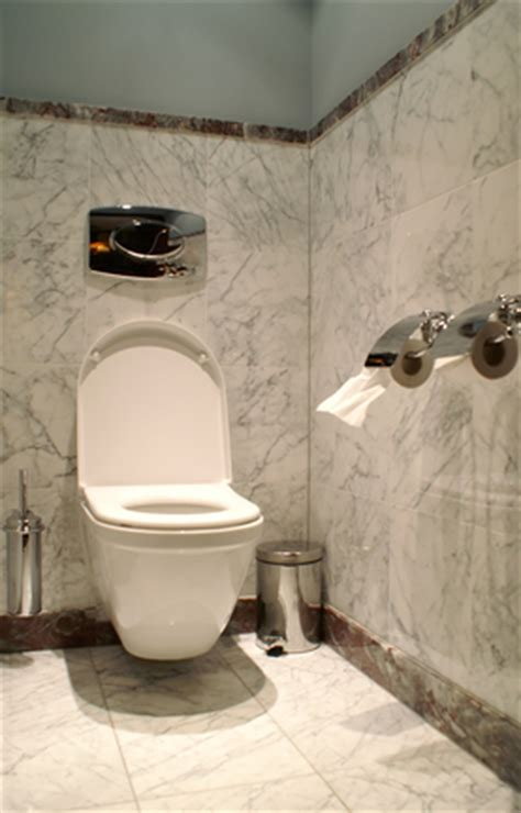 did you get something stuck in the toilet here s how to get it out