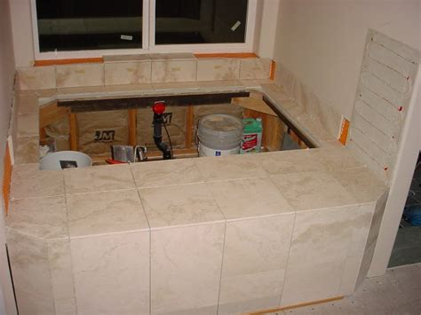 how to tile a bathtub area home improvement
