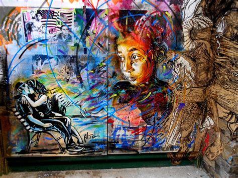 a graffiti mural by artist c215 of