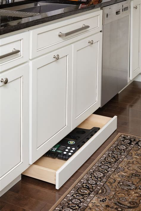 storage drawers in the toekick the cabinets baseboard drawers kitchen