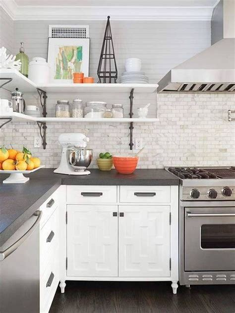 grey countertops edge cut white cabinets marble looking subway tile backsplash kitchen