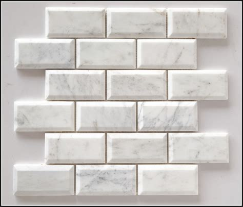 white beveled subway tile with grey grout page