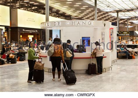stores and passengers at an airport gate waiting area baa heathrow stock photo royalty free
