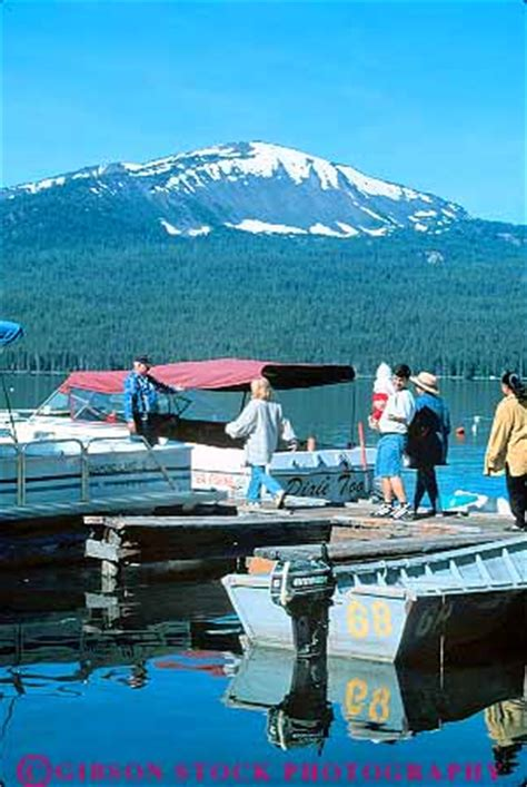 Diamond Lake Boat Rentals by People Renting Boats At Dock Diamond Lake Oregon Stock