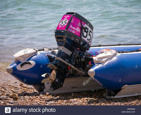 Inflatable Boat Outboard by An Outboard Motor On The Rear Of A Thundercat Racing Rigid