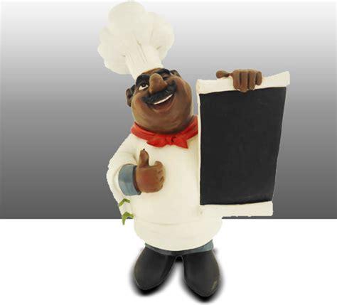 black chef kitchen statue with menu board table decor