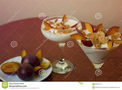 yogurt dessert with plums and wheat flakes healthy