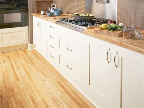 How To Lay Floating Floorboards Ikea Kitchen Cabinet Installation Instructions Best Rated Cabinets Lowes Without Doors White Corner For Replacement Soft Close Martha Stewart Living